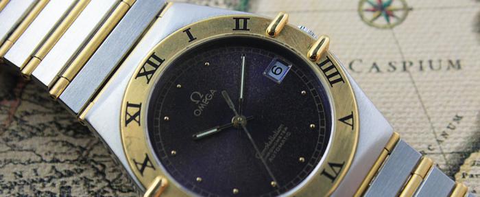 上打全金下打全钢的间金手表