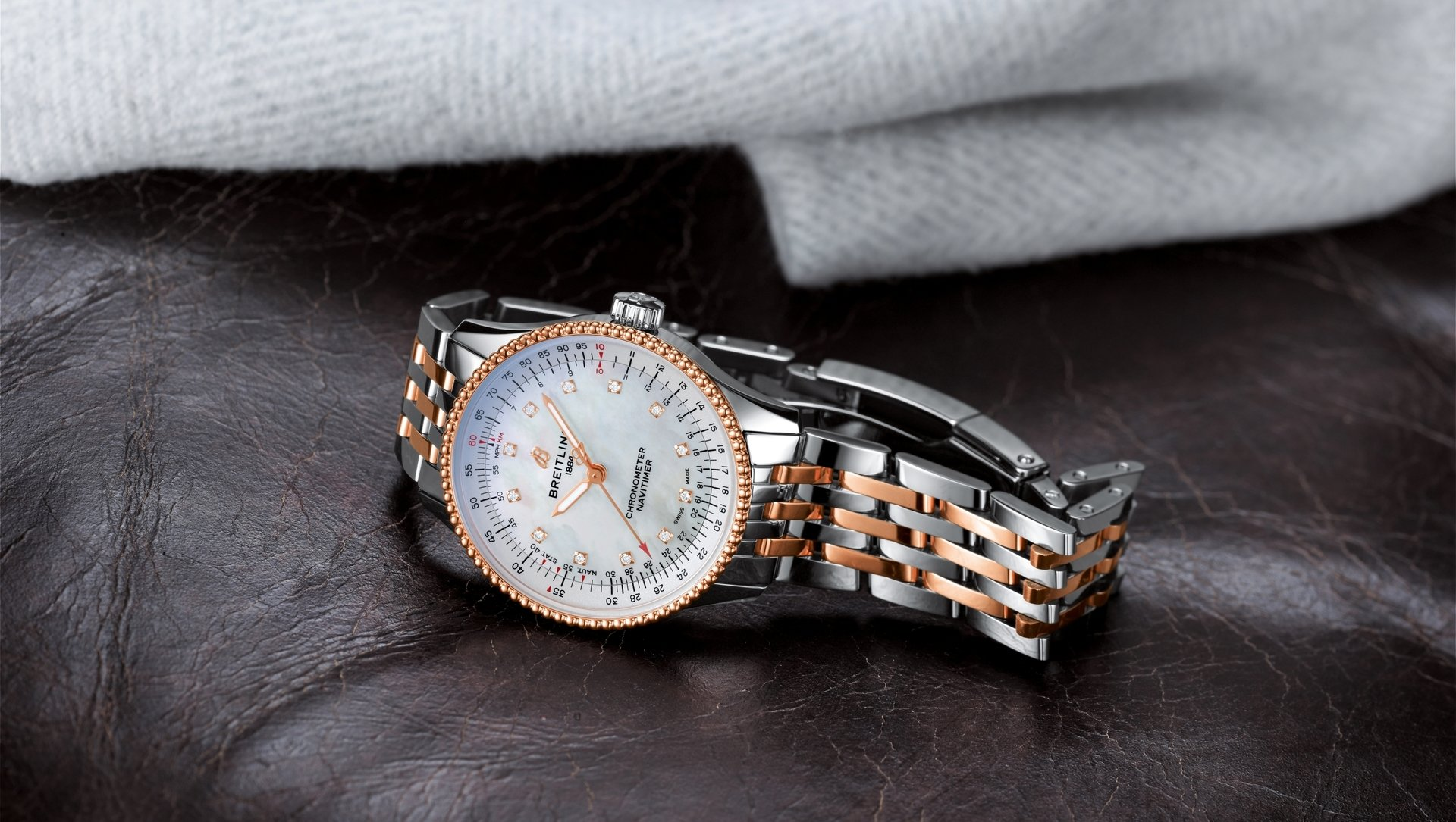 11_two-tone-navitimer-automatic-35-with-a-white-mother-of-pearl-dial-with-diamond-hour-markers-and-a-luxurious-18-k-red-gold-bezel.jpg