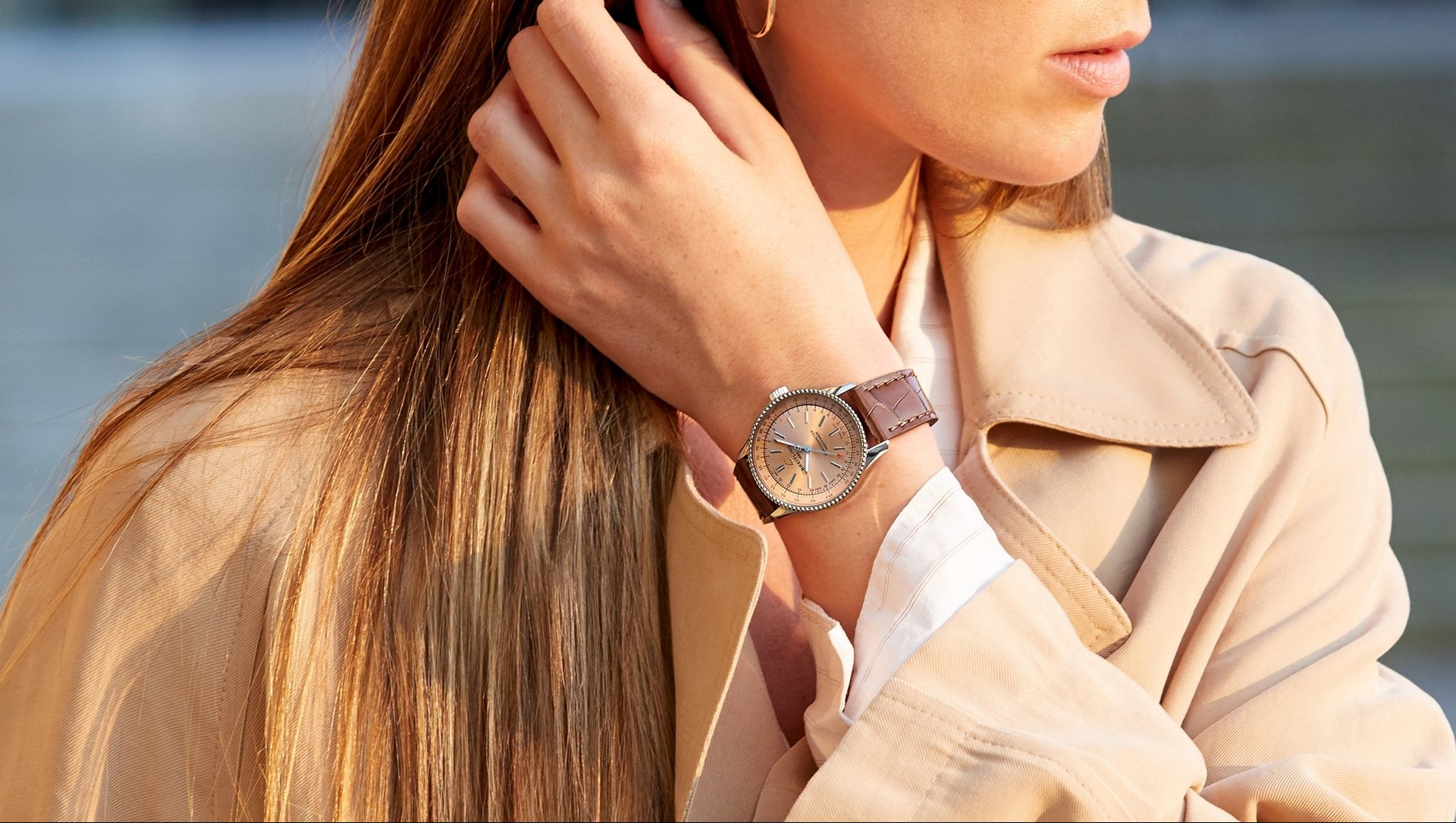 16_female-model-wearing-the-navitimer-automatic-35-with-a-copper-colored-dial-and-diamond-hour-markers-with-a-burgundy-alligator-leather-strap.jpg
