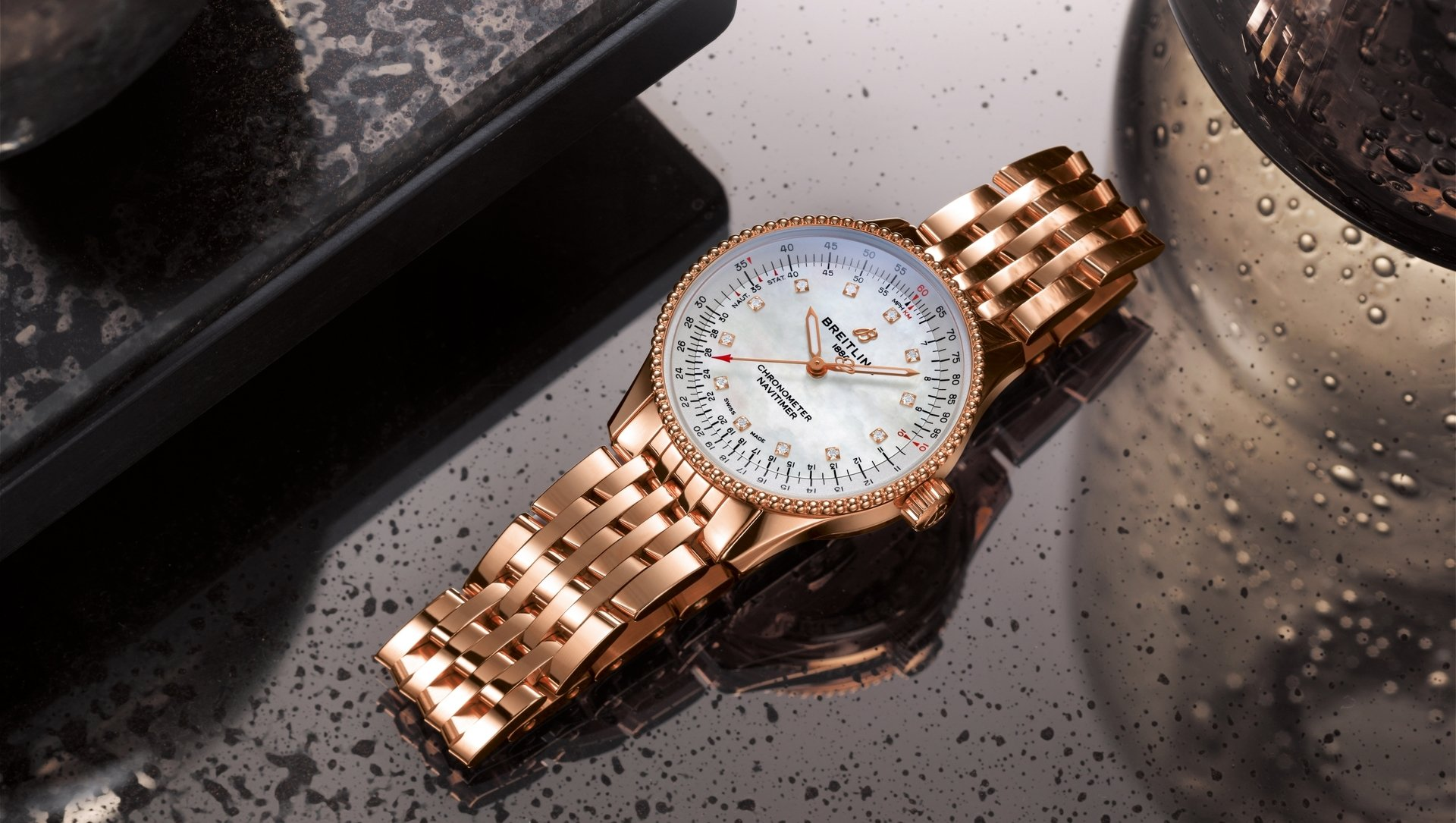 13_navitimer-automatic-35-in-18-k-red-gold-with-a-white-mother-of-pearl-dial-with-diamond-hour-markers-and-an-18-k-red-gold-navitimer-bracelet.jpg