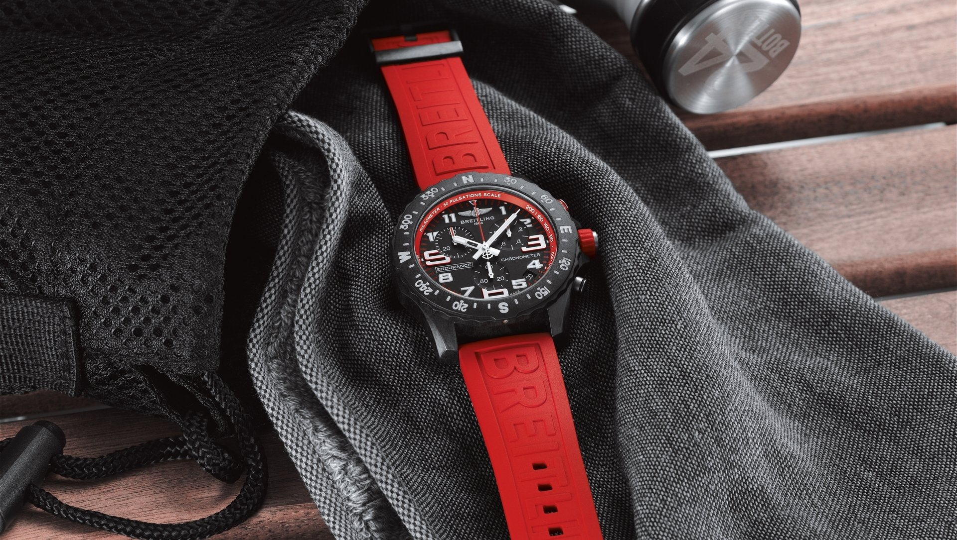 03_endurance-pro-with-a-red-inner-bezel-and-rubber-strap.jpg