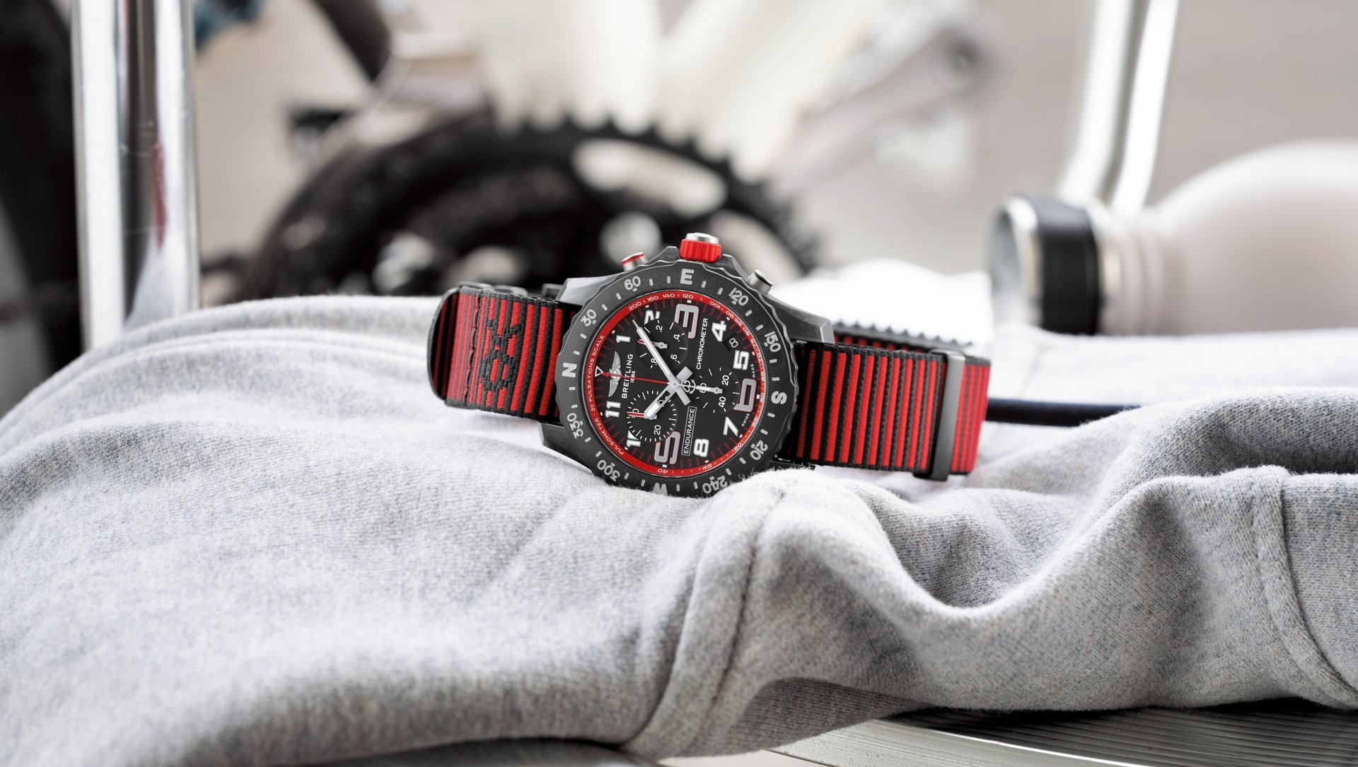 04_endurance-pro-with-a-red-inner-bezel-and-outerknown-econyl-yarn-nato-strap.jpg