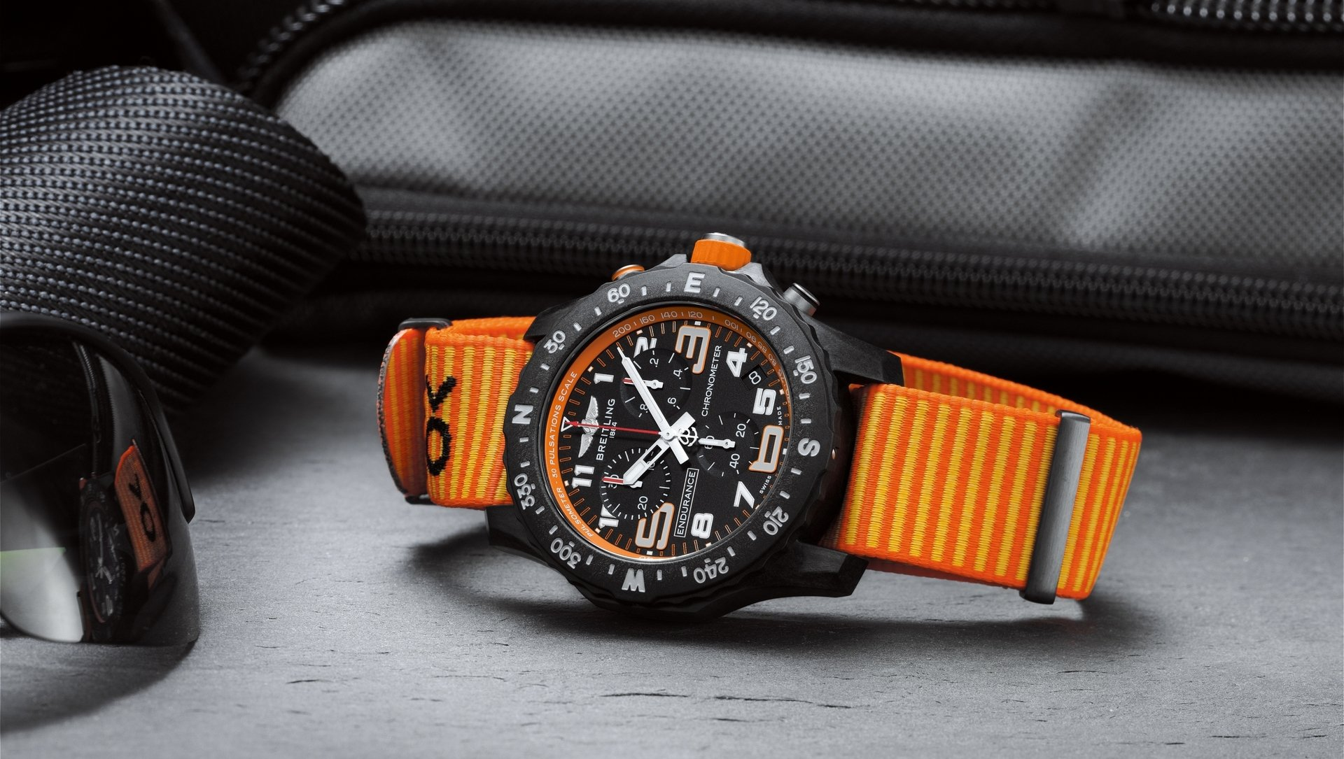 08_endurance-pro-with-an-orange-inner-bezel-and-outerknown-econyl-yarn-nato-strap.jpg